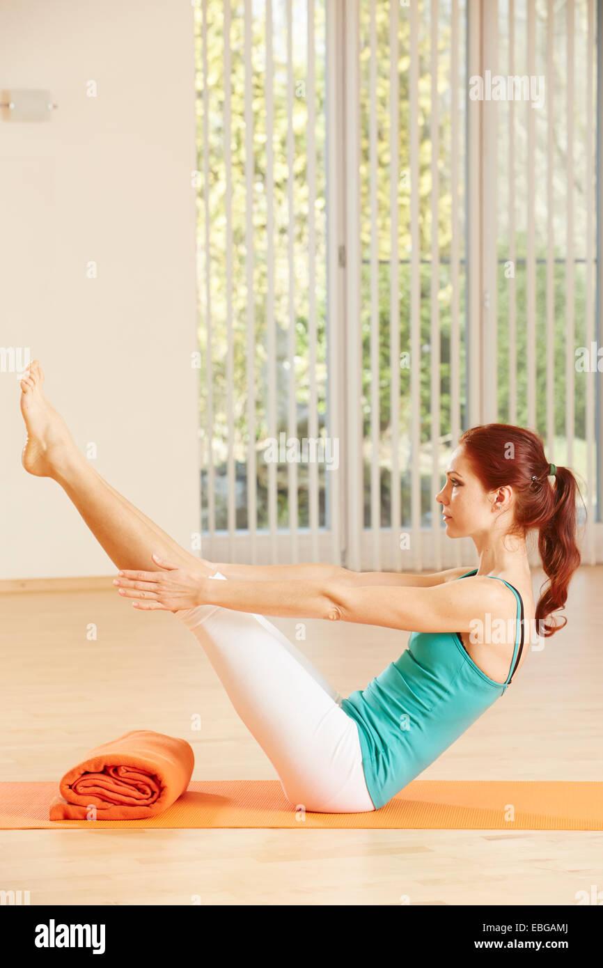 Woman doing pelvic floor exercises - Stock Image
