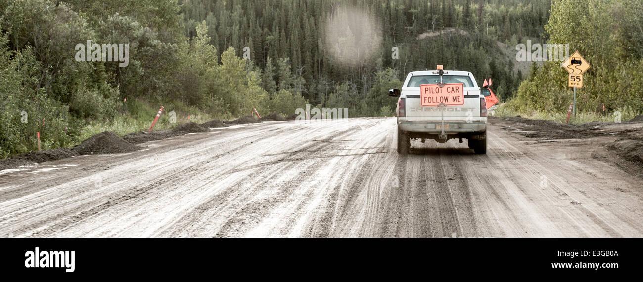 Pilot Car driving in Alaska - Stock Image