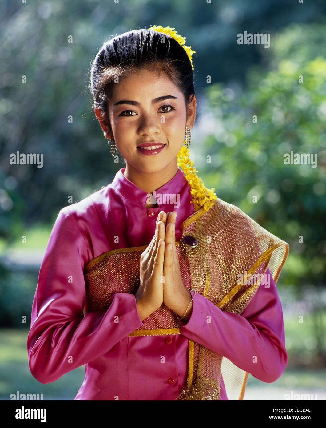 Thai wai greeting stock photos thai wai greeting stock images alamy the wai a thai gesture of greeting young woman wearing a traditional costume m4hsunfo