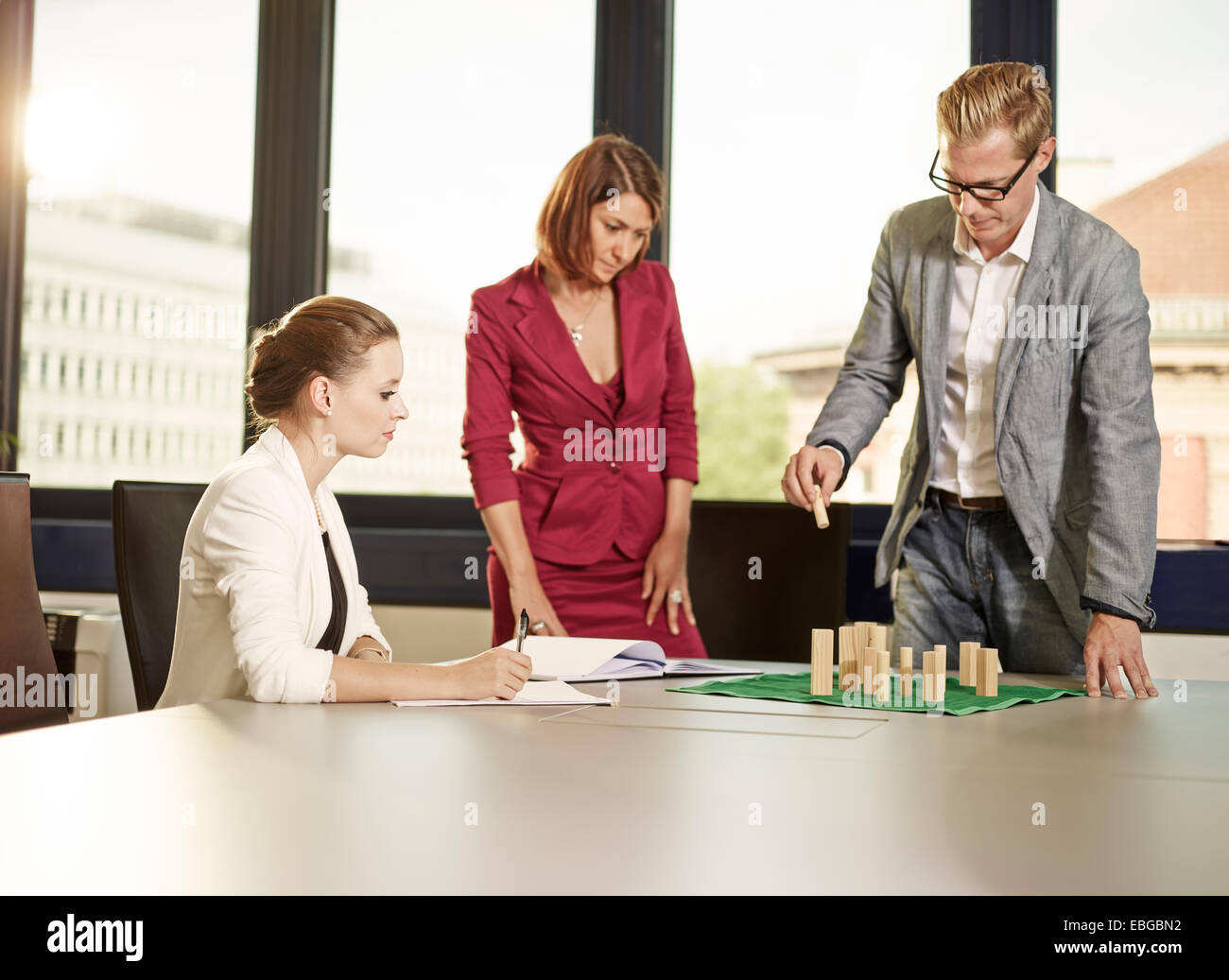 Business coach with clients using a system board, Innsbruck, Tyrol, Austria - Stock Image