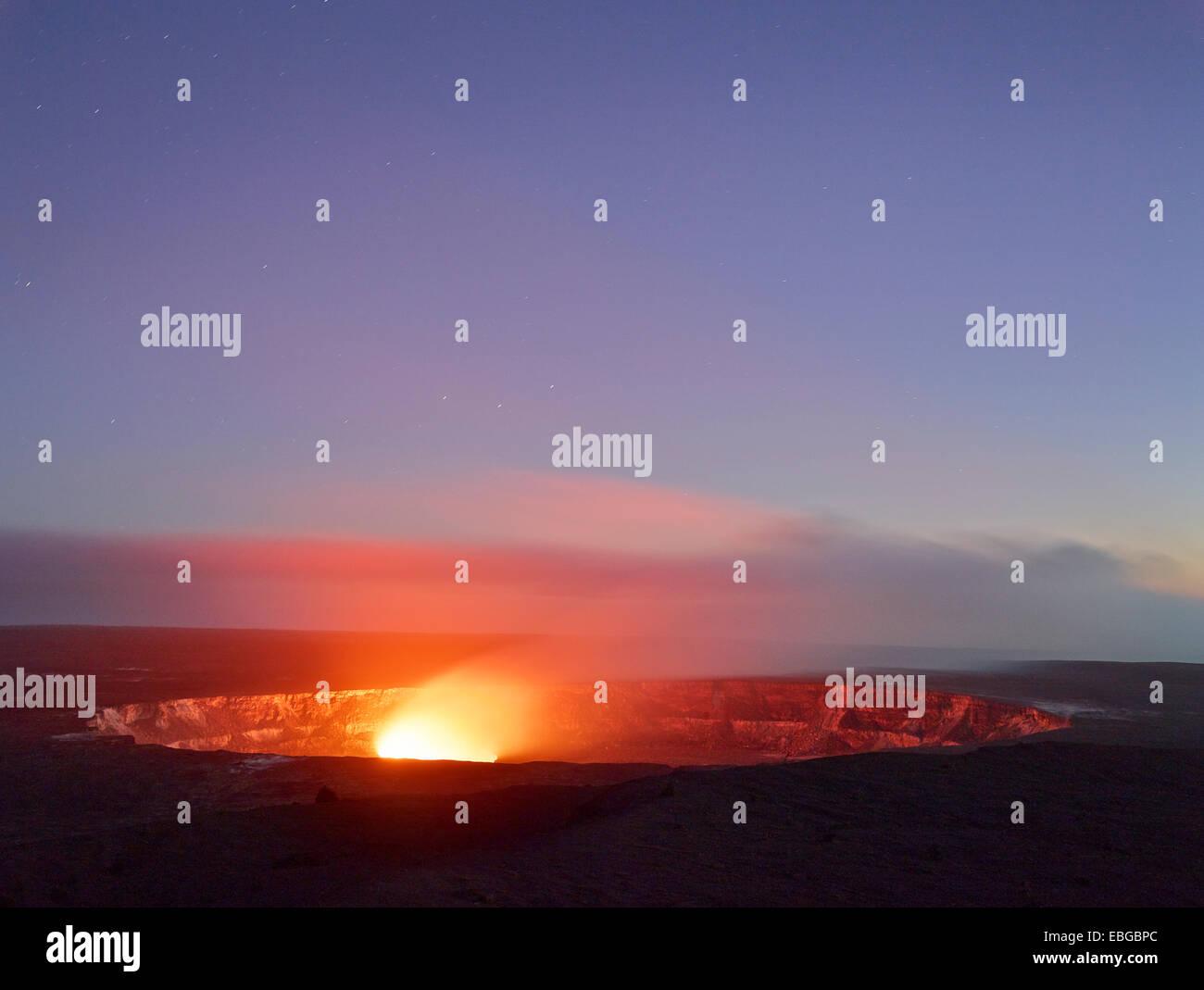 Halema'uma'u or Halemaumau crater, Kilauea crater, volcanic eruption, lava, red hot lava flow, in the evening - Stock Image