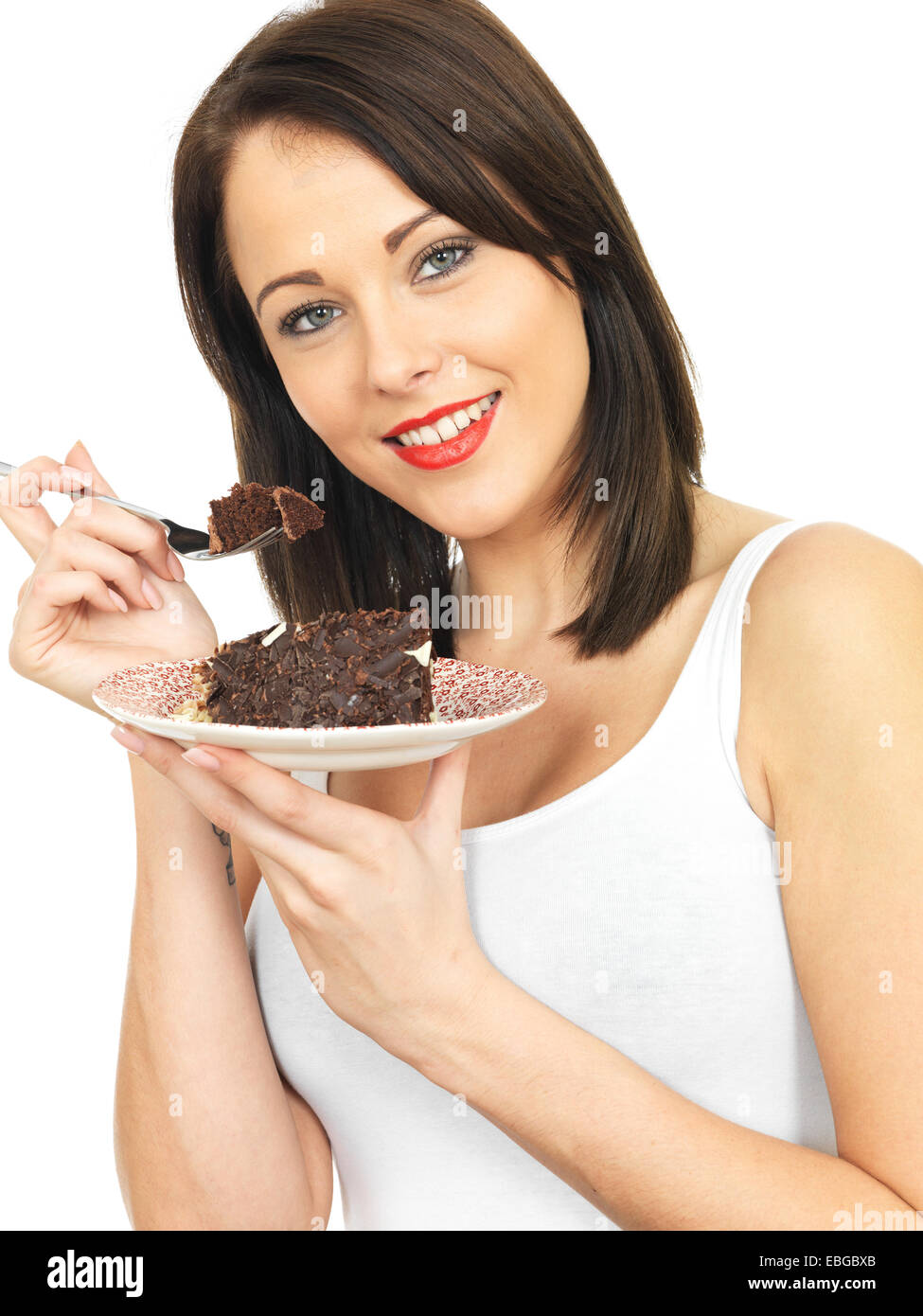 Attractive Twenty Something Young Woman Eating Chocolate Cake - Stock Image