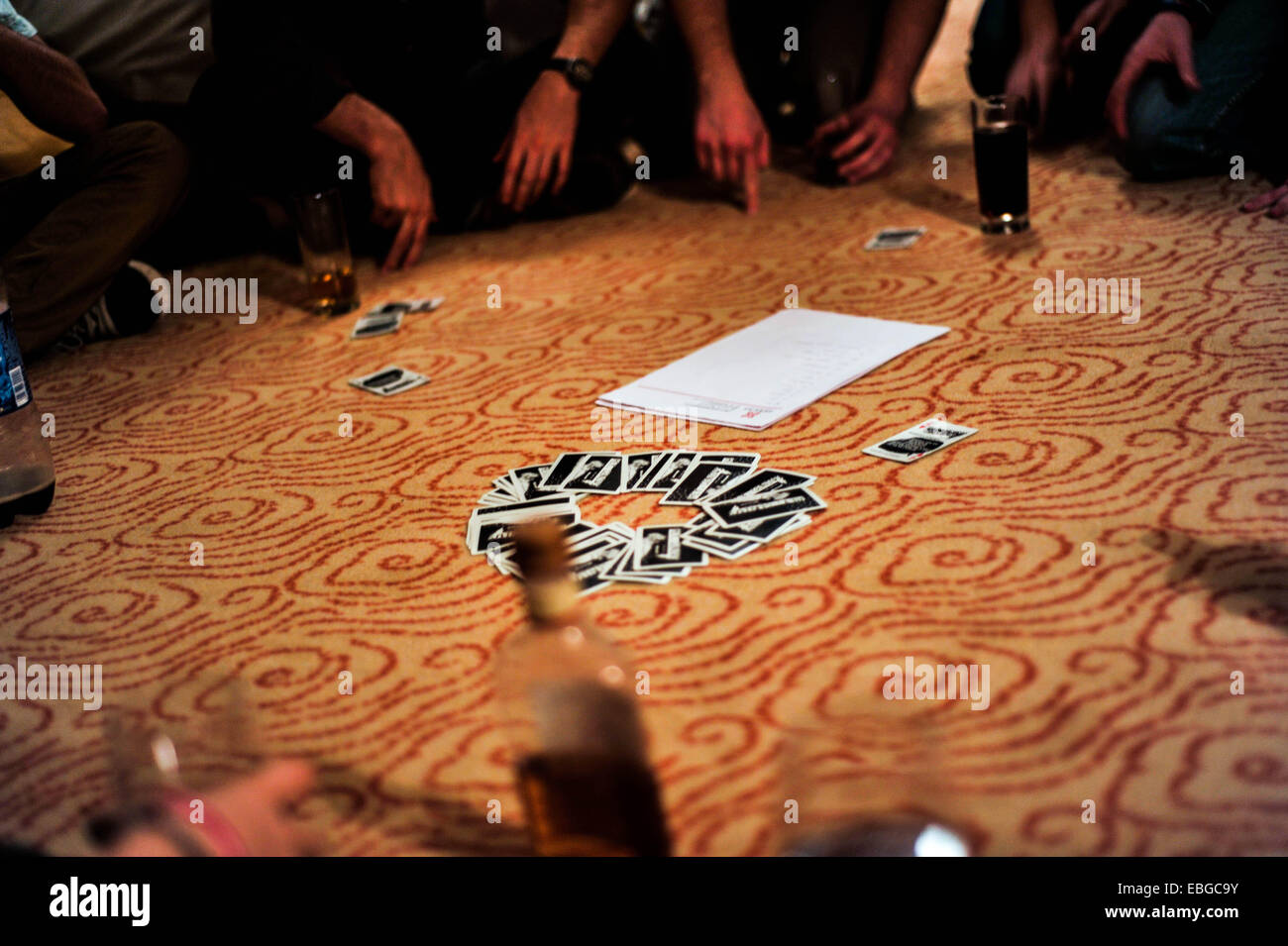 Game of Ring of Fire on the floor in a room - Stock Image
