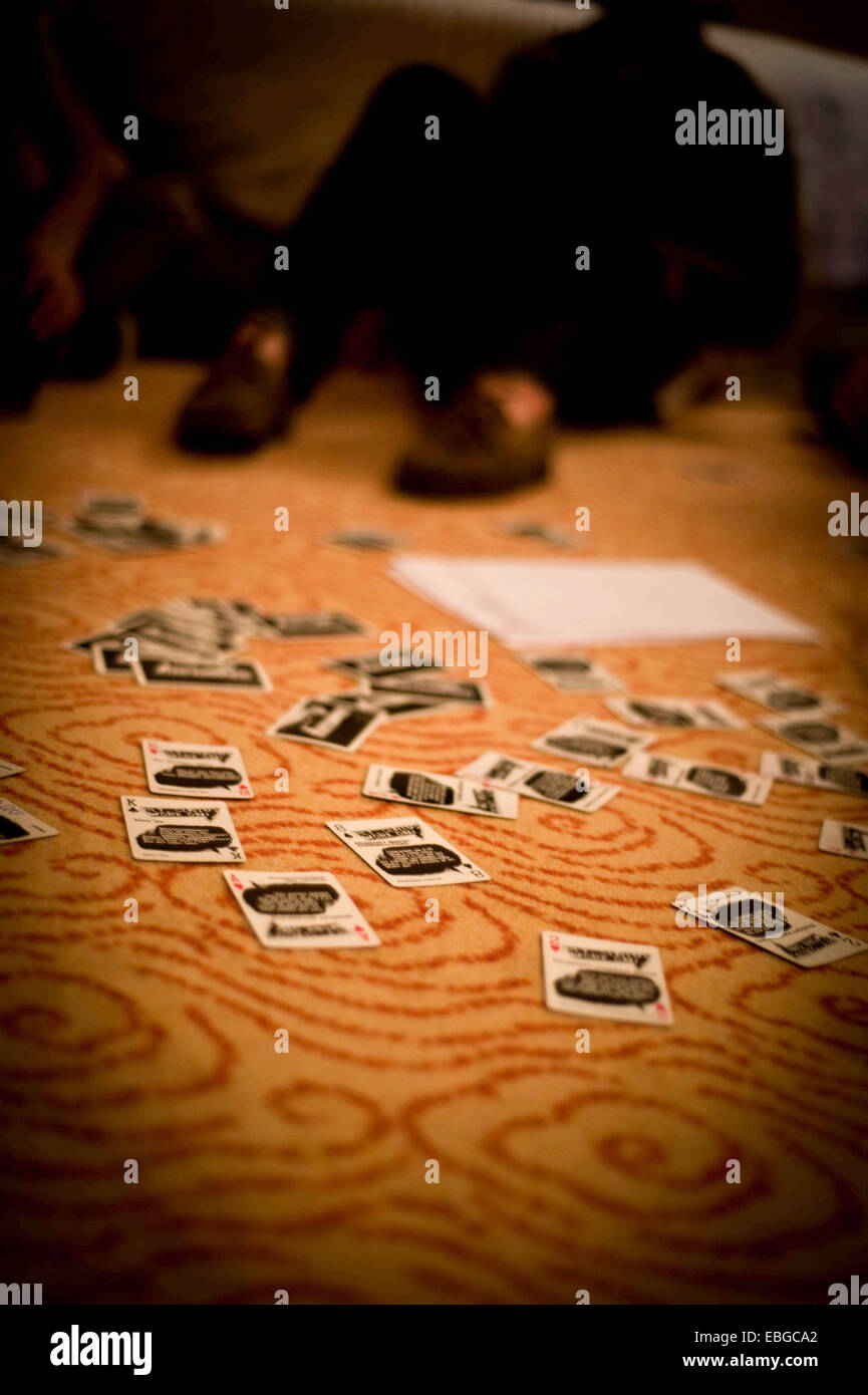 Game of Ring of Fire on a carpet in a hotel room - Stock Image