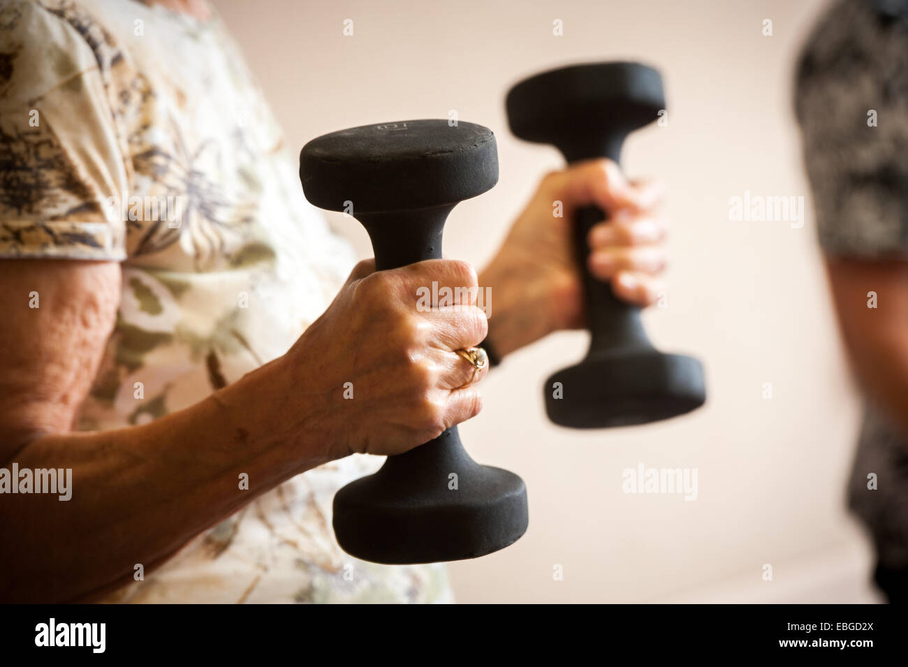 Senior woman with weights - Stock Image