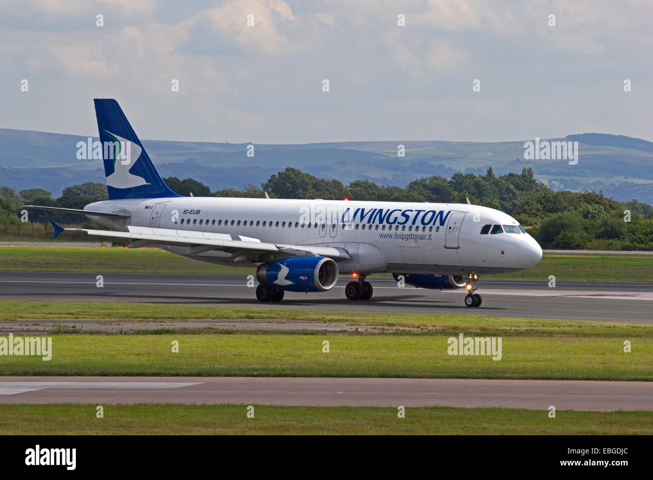 Livingston Airbus A320-232 taxiing at Manchester Airport - Stock Image