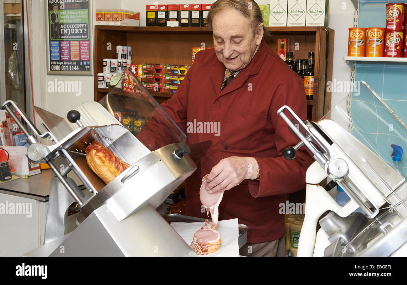 Shopkeeper Tony Whatling who has run the shop and post office in Westhall, Suffolk for over 60 years. - Stock Image