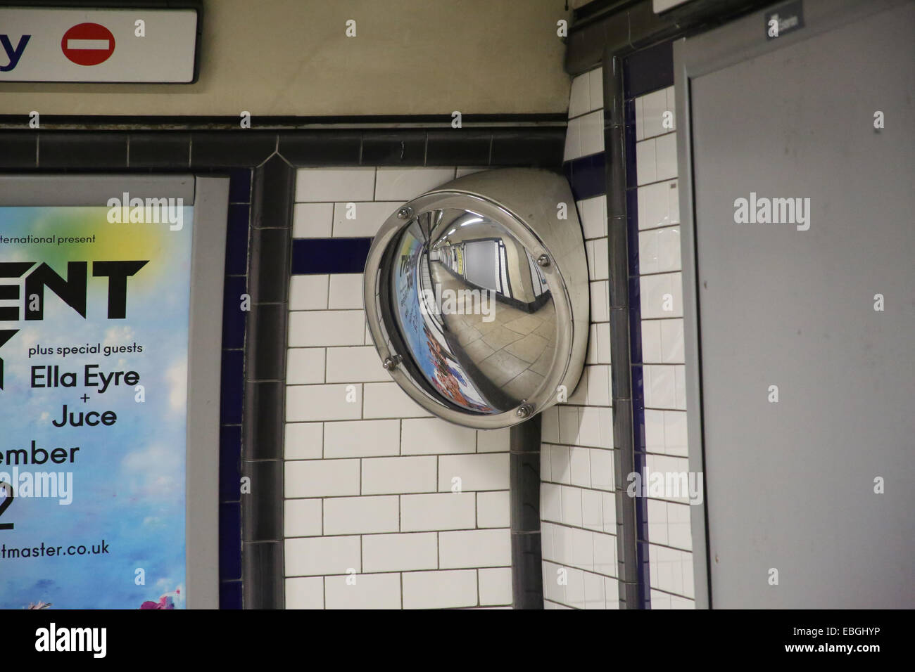 A convex security mirror at Kennington TFL underground tube station, London - Stock Image