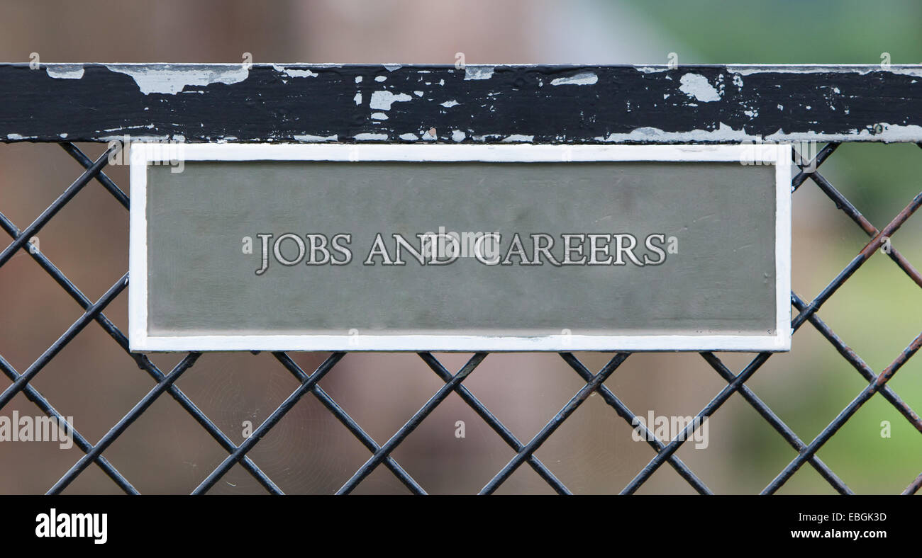 Sign hanging on an old metallic gate - Jobs and careers - Stock Image