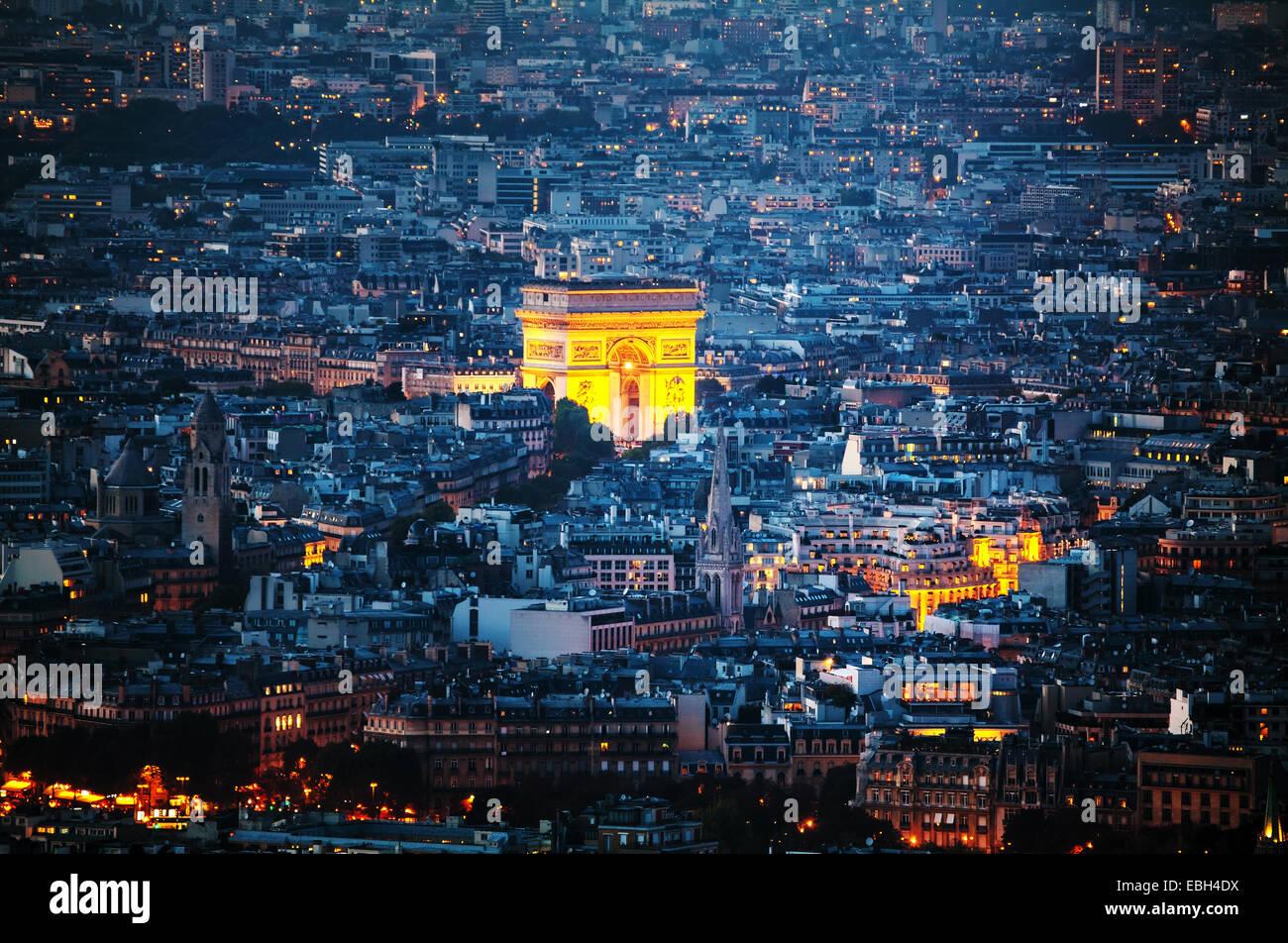 Aerial view of Arc de Triomphe de l'Etoile (The Triumphal Arch) in Paris at night - Stock Image