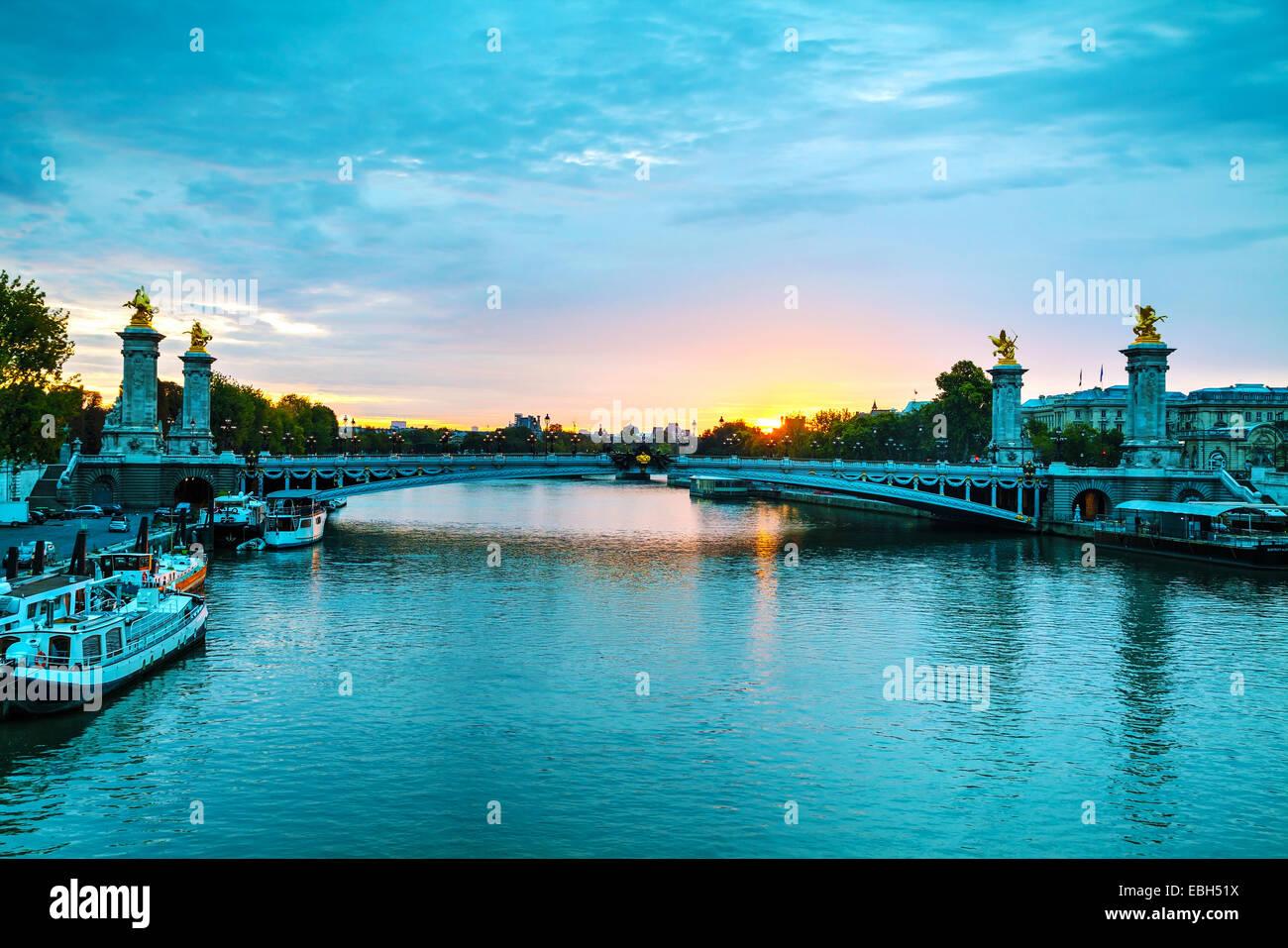 Paris with Aleksander III bridge at sunrise - Stock Image