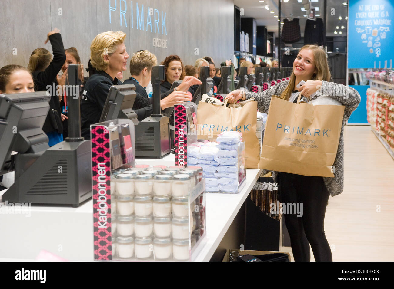 ENSCHEDE, NETHERLANDS -AUG 19, 2014: People are shopping in a new branch of warehouse Primark on the first day at - Stock Image