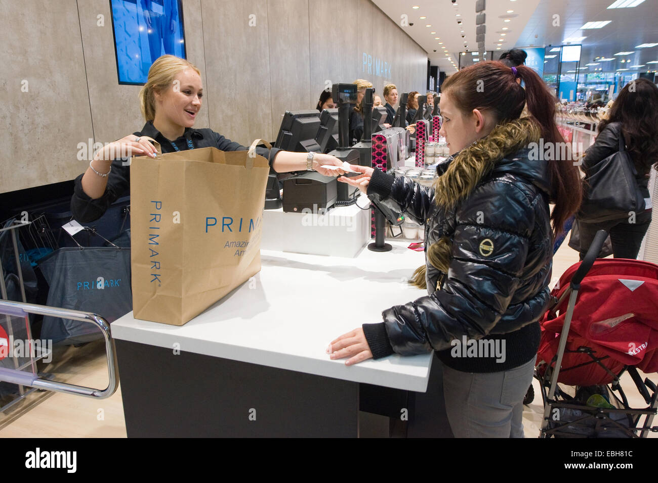 ENSCHEDE, NETHERLANDS - AUG 19, 2014: People are shopping in a new branch of warehouse Primark on the first day - Stock Image