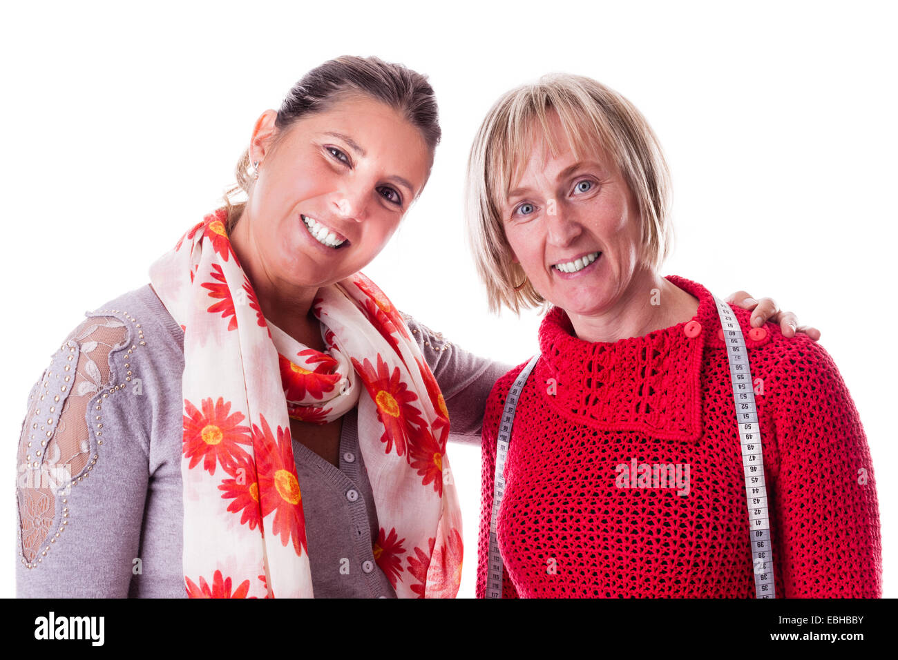 two happy seamstresses isolated over a white background - Stock Image