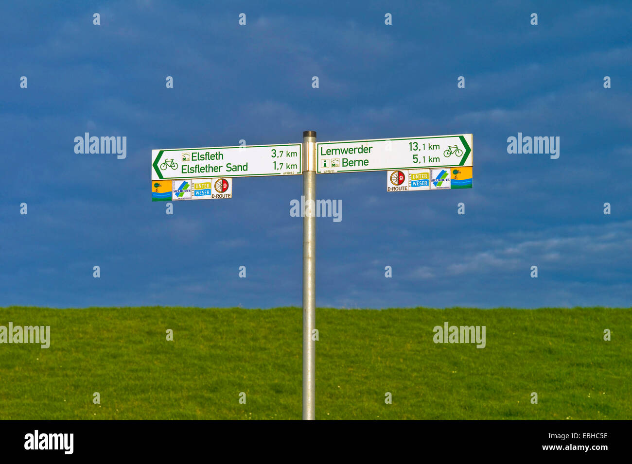 direction signs for bicyclists in Orth county Wesermarsch, Germany, Lower Saxony - Stock Image