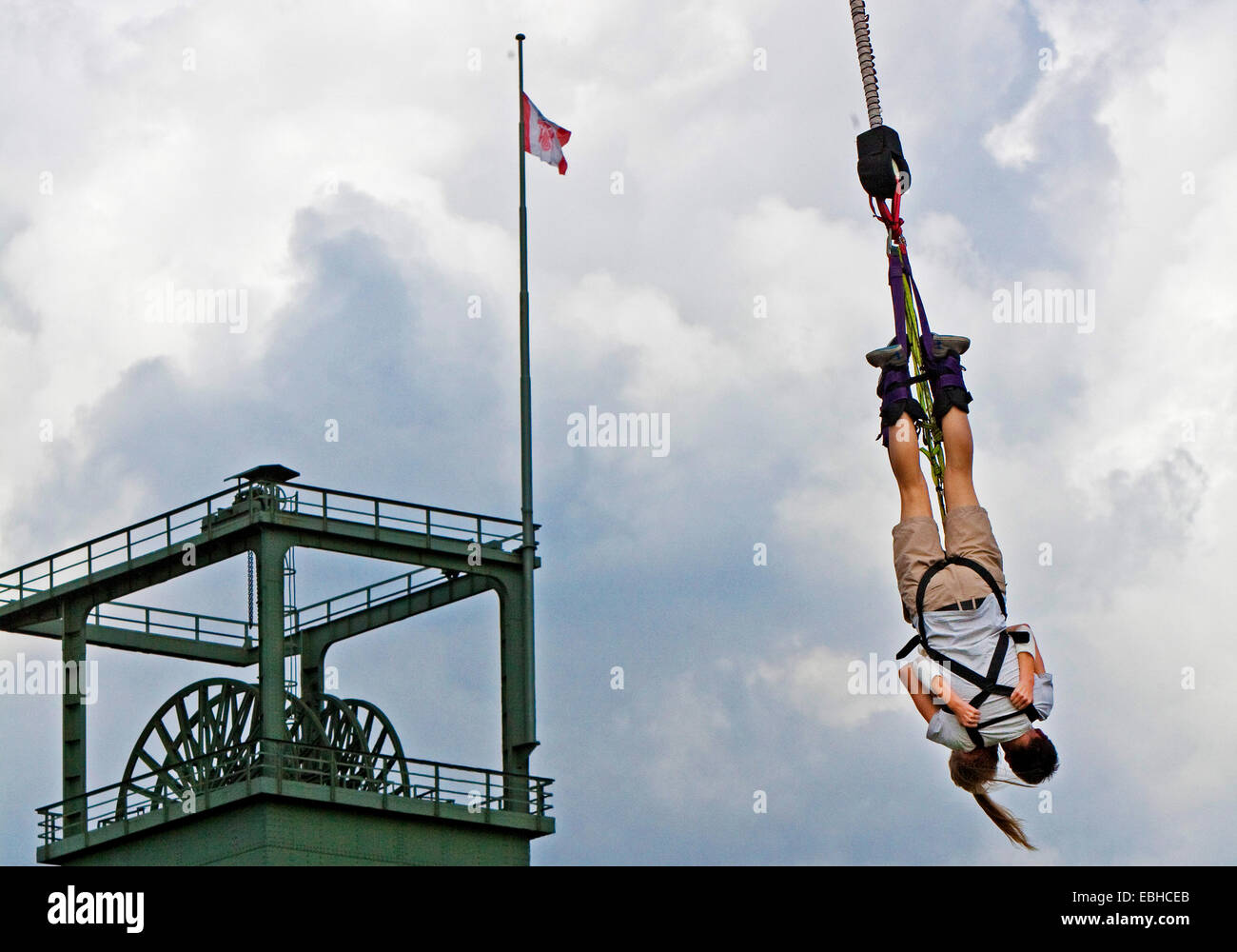 bungee jumping in front of a pit frame in Olga Park, Germany, North Rhine-Westphalia, Ruhr Area, Oberhausen Stock Photo