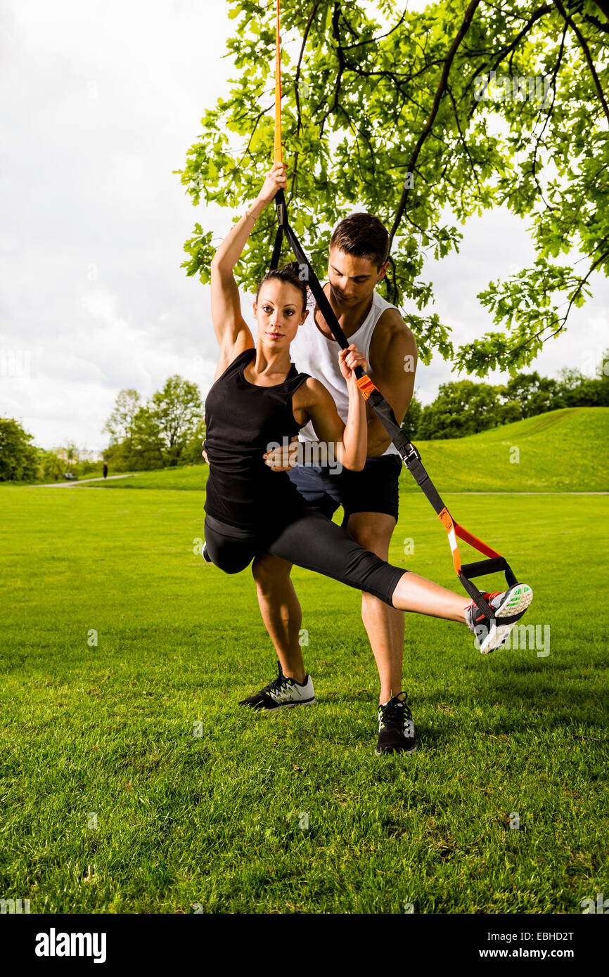 Personal trainers doing outdoor training in urban place, Munich, Bavaria, Germany Stock Photo