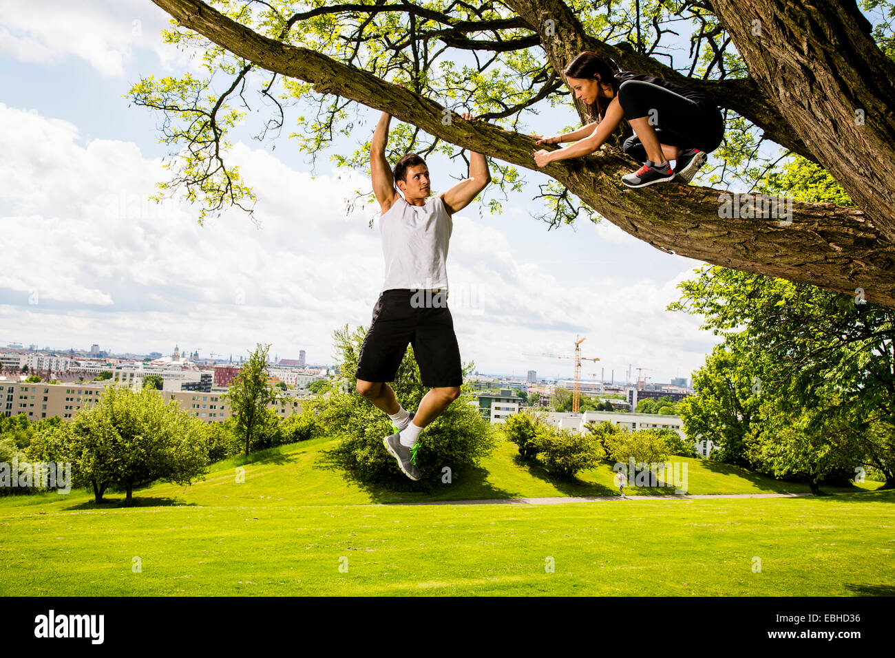 Personal trainers doing outdoor training in urban place, Munich, Bavaria, Germany - Stock Image