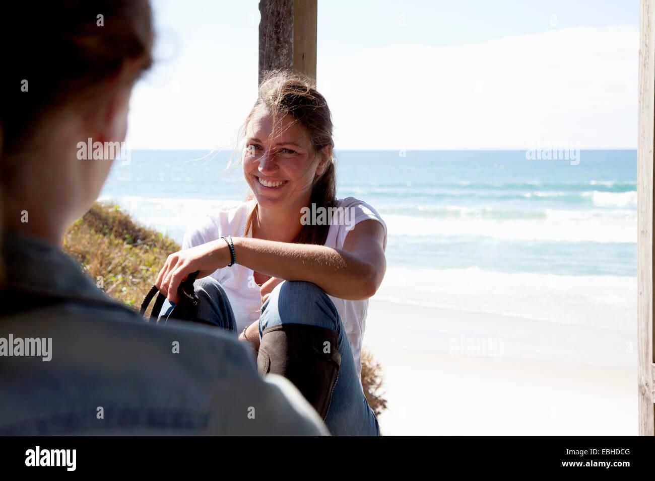 Horse riders taking break, Pakiri Beach, Auckland, New Zealand Stock Photo