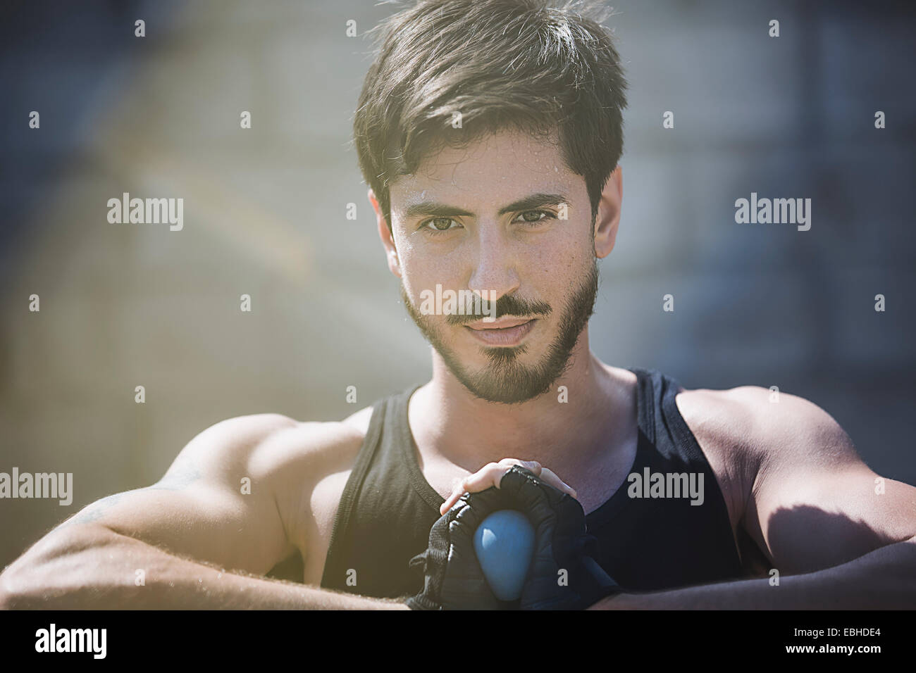 Portrait of young male handball player holding ball - Stock Image