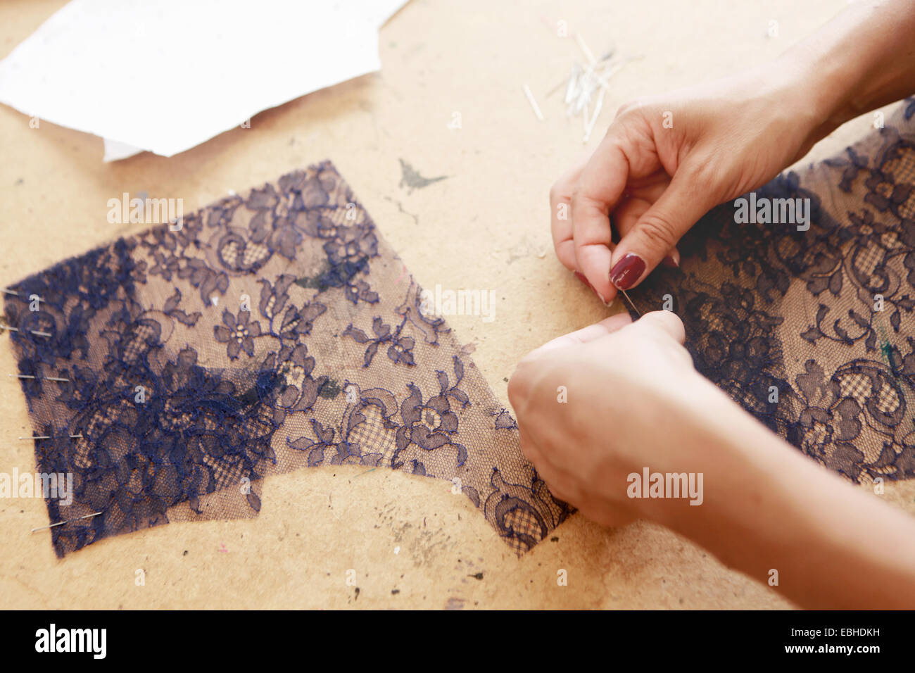 Designer at work in studio - Stock Image