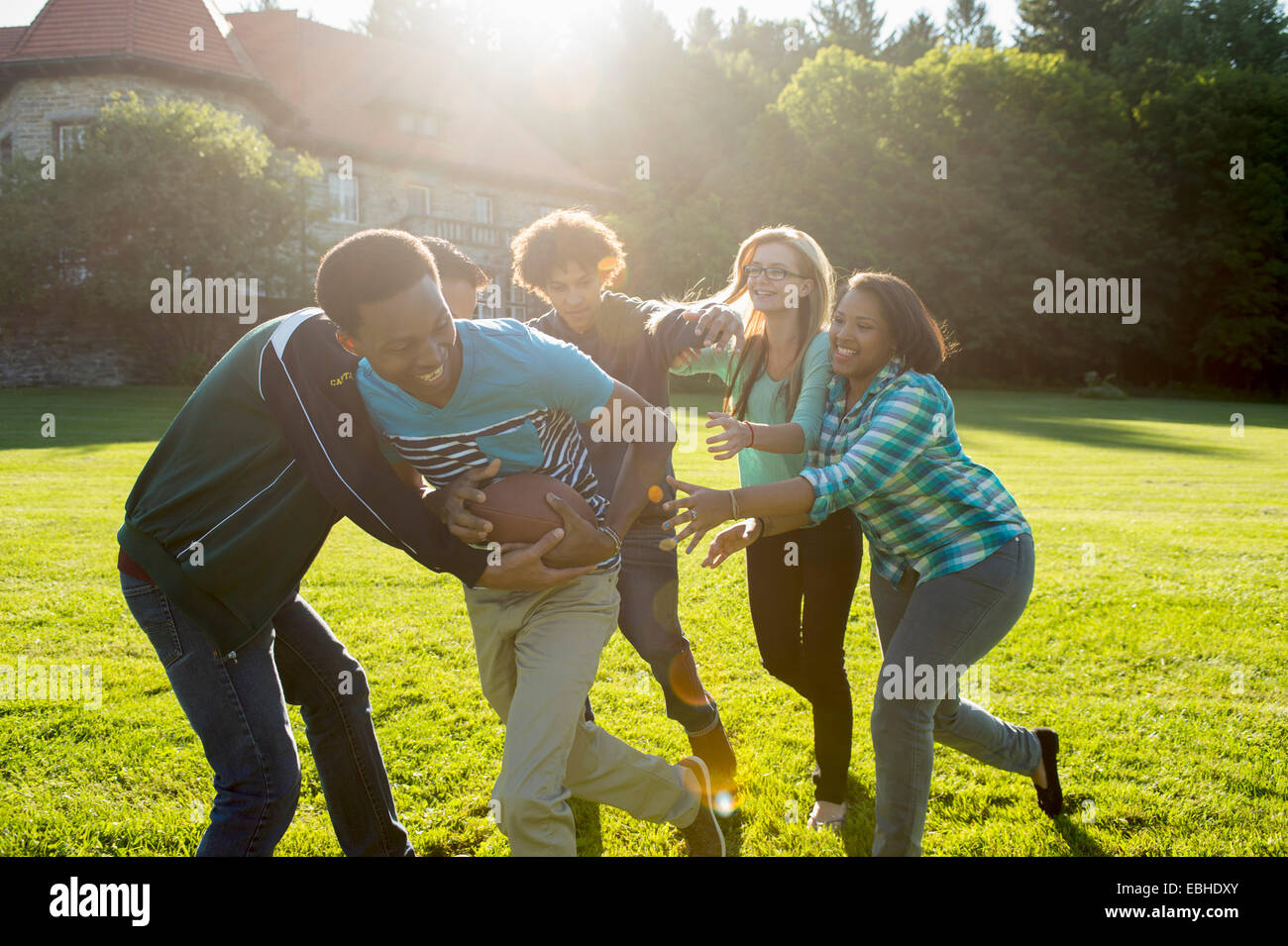 Students playing American football - Stock Image