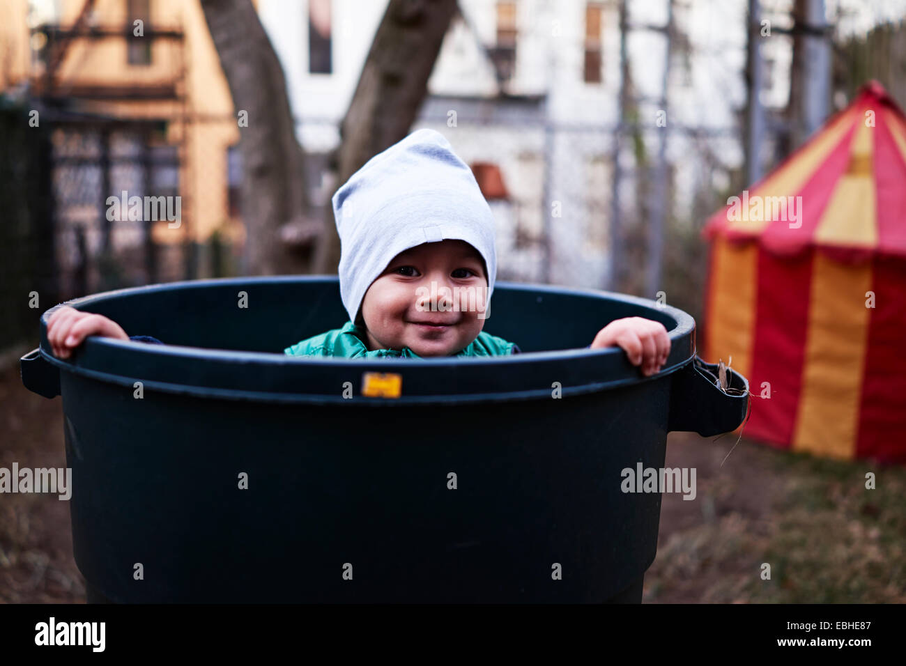 Boy inside tub, Brooklyn, New York, USA - Stock Image