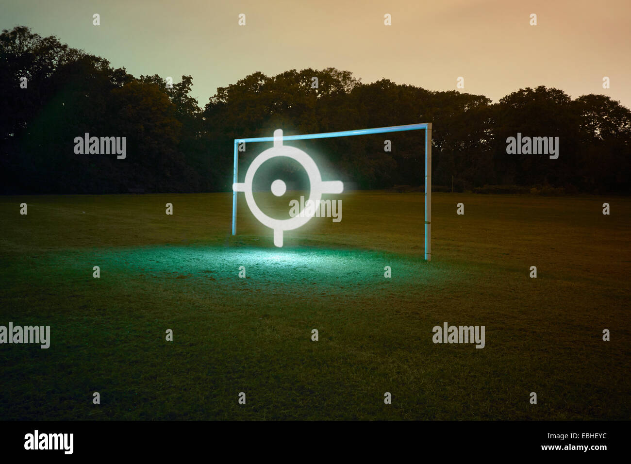 Football goal with illuminated target symbol - Stock Image