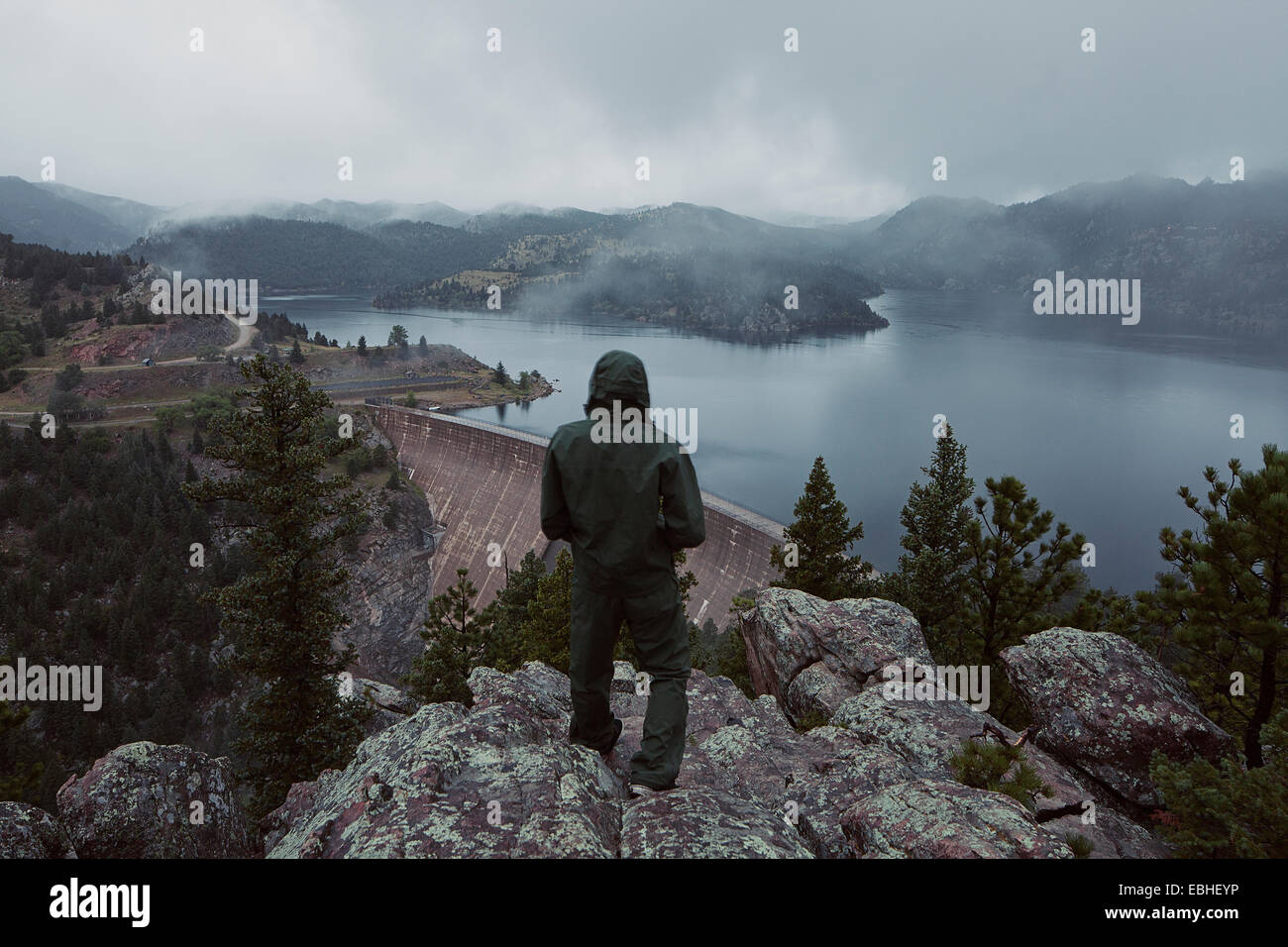 Man overlooking the Gross Dam in Colorado, USA - Stock Image
