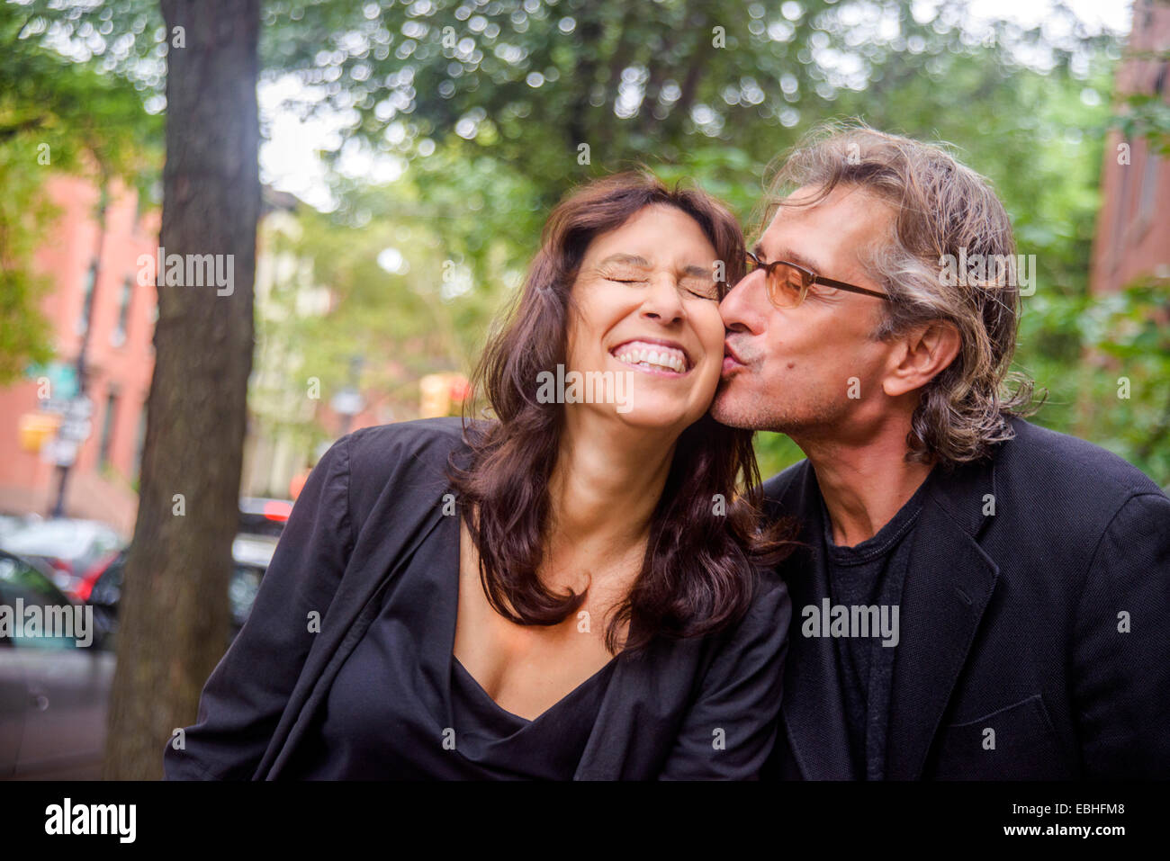 Portrait of romantic mature couple on city street - Stock Image