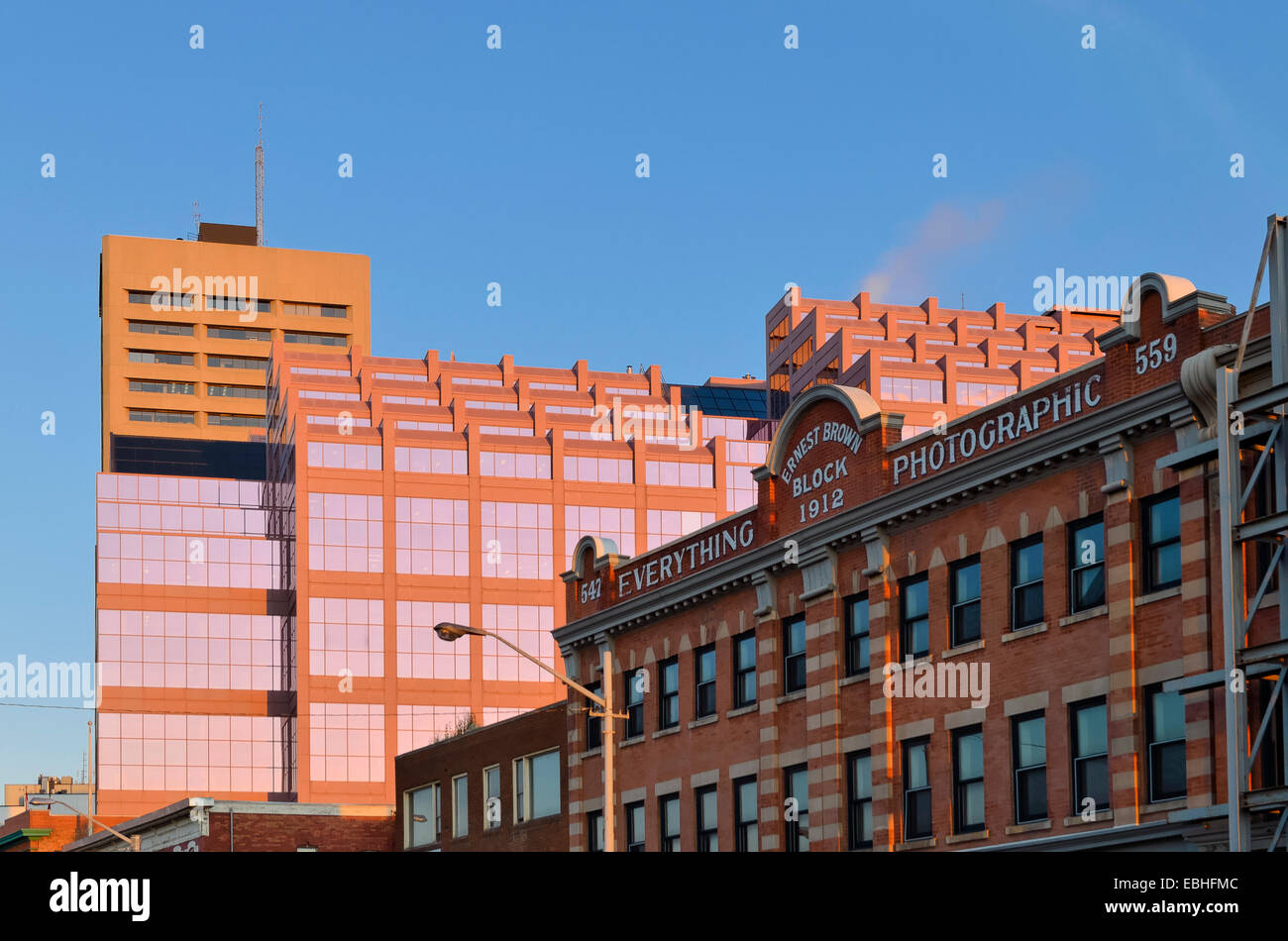 Everything Photographic, an old brick building contrasts with modern Canada Place. Edmonton, Alberta, Canada - Stock Image