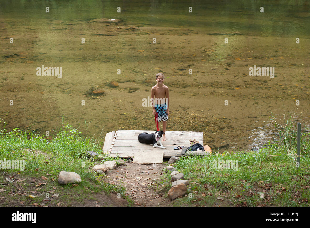 Portrait of teenage boy standing on pier, Canton, North Carolina, USA - Stock Image