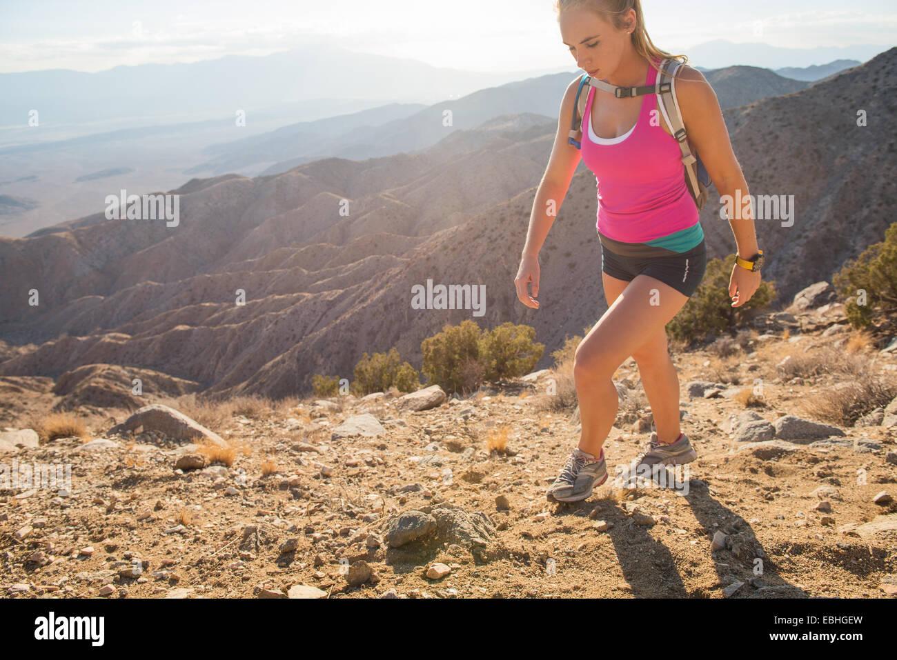 Woman hiking, Joshua Tree National Park, California, US - Stock Image