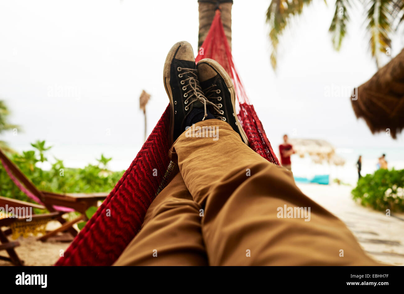 Mature mans self portrait of legs in beach hammock - Stock Image