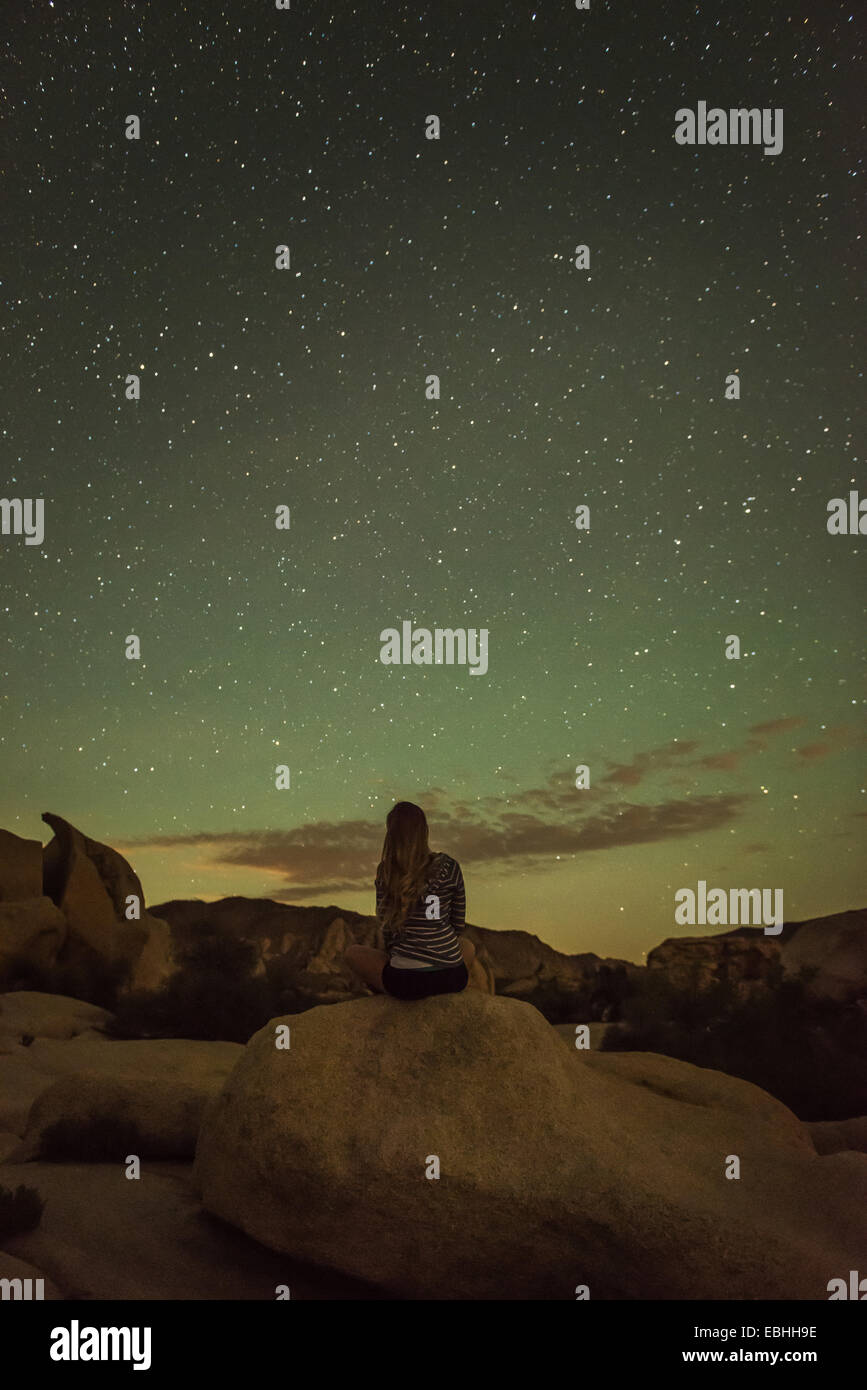 Woman, starry night, Joshua Tree National Park, California, US - Stock Image