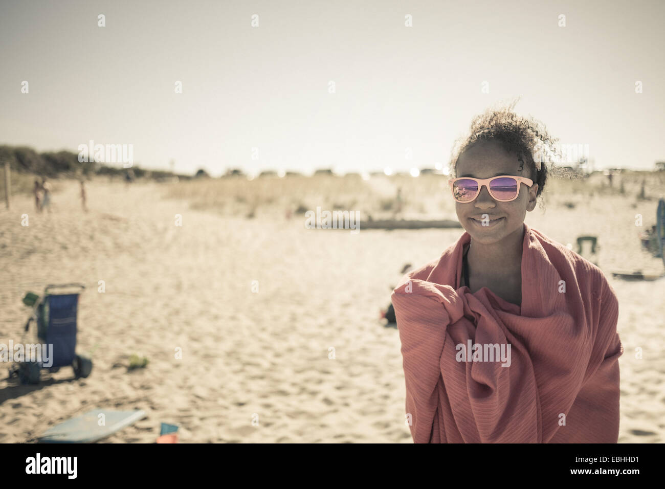 Girl wrapped in towel on beach, Truro, Massachusetts, Cape Cod, USA - Stock Image