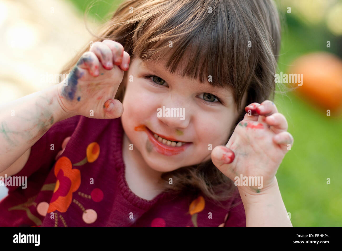 Girl with messy hands - Stock Image