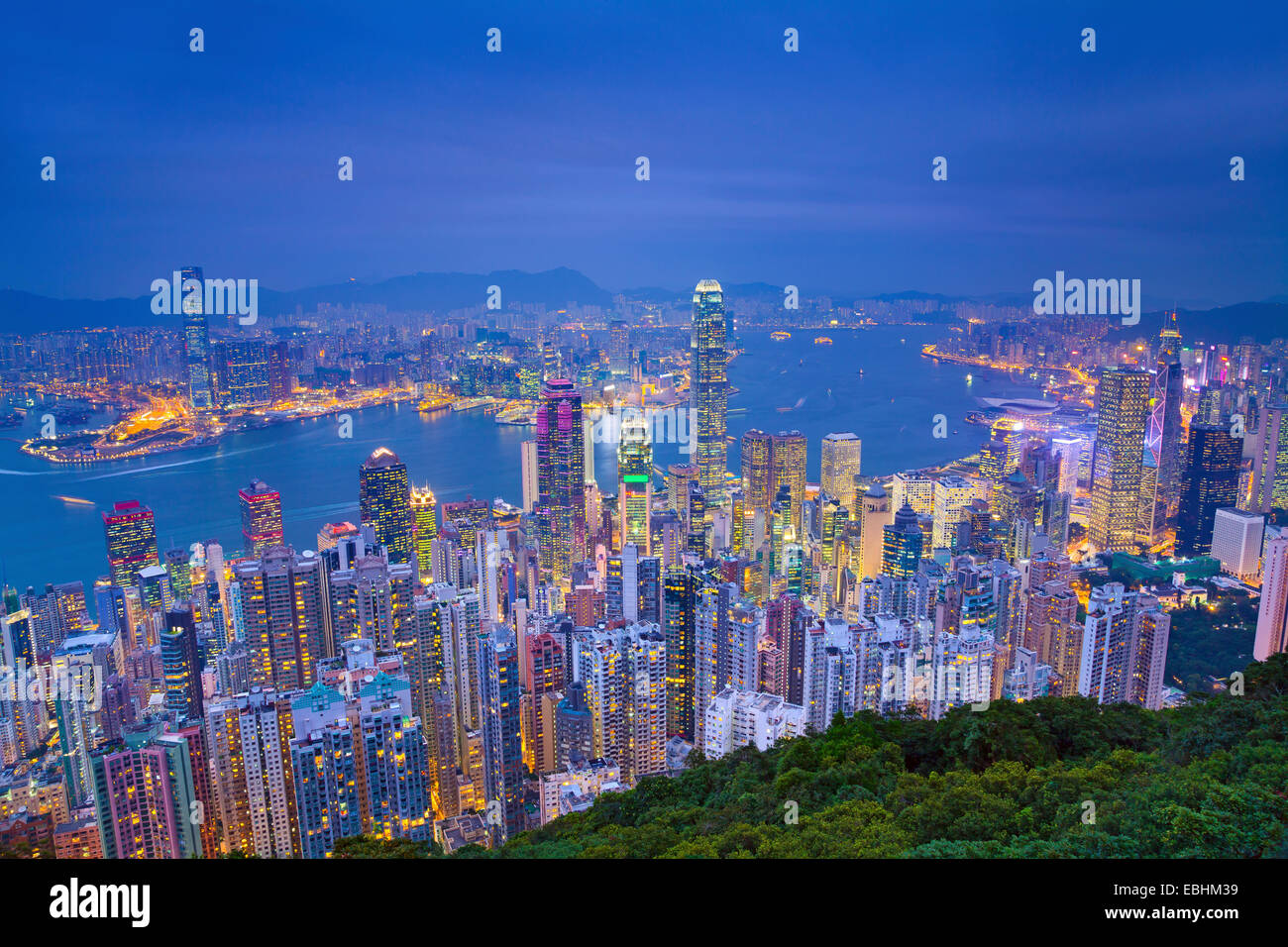 Hong Kong. Image of Hong Kong with many skyscrapers during twilight blue hour. - Stock Image