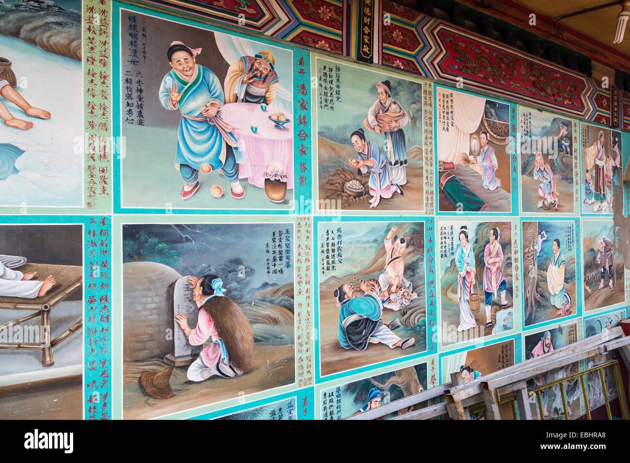 Story panel in Chinese on wall of Tua Pek Kong Chinese Temple, Miri, Sarawak, Malaysia - Stock Image