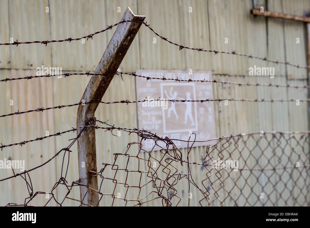 Old barbed wire fence around building, Miri, Malaysia Stock Photo ...