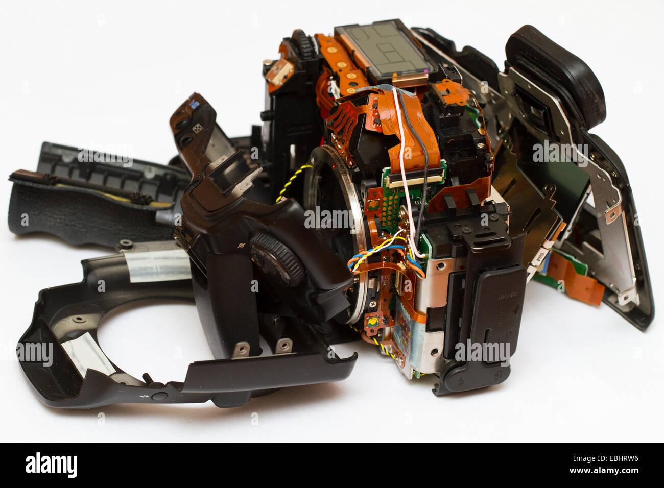 DSLR camera, broken into pieces. - Stock Image