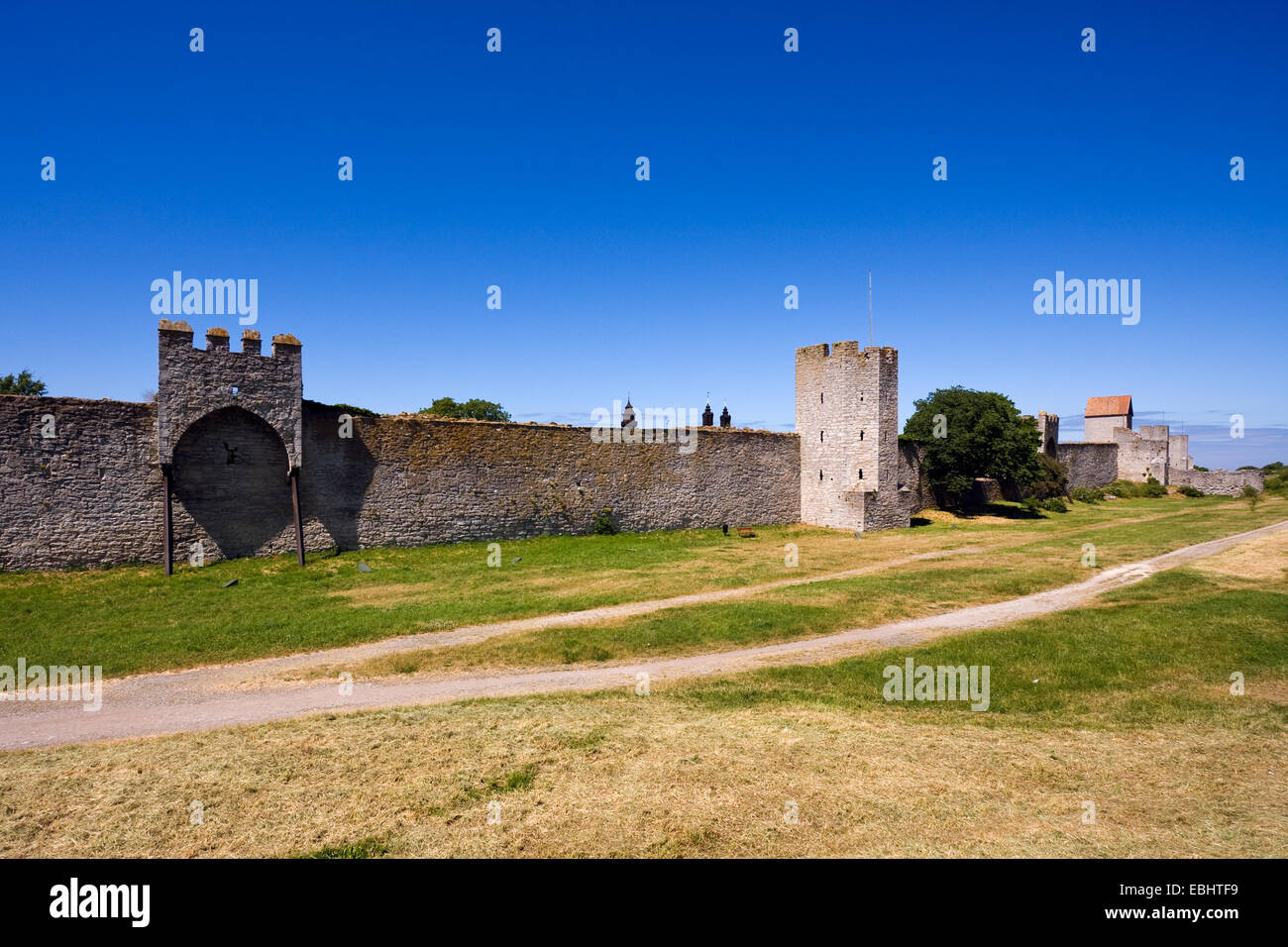The old city wall surrounding the Hanseatic town of Visby, a UNESCO World Heritage, on the island of Gotland in - Stock Image