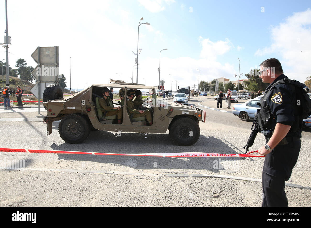 Jerusalem. 1st Dec, 2014. Israeli police and soldiers are seen on the site of an alleged stabbing attack outside - Stock Image