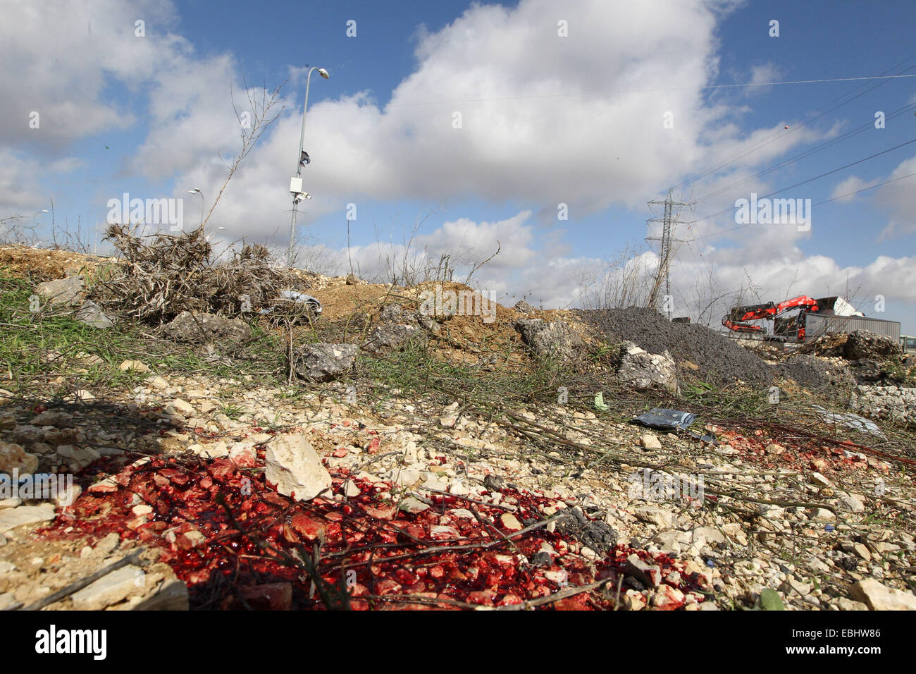 Jerusalem. 1st Dec, 2014. Blood stains are seen on the site of an alleged stabbing attack outside the Jewish settlement - Stock Image