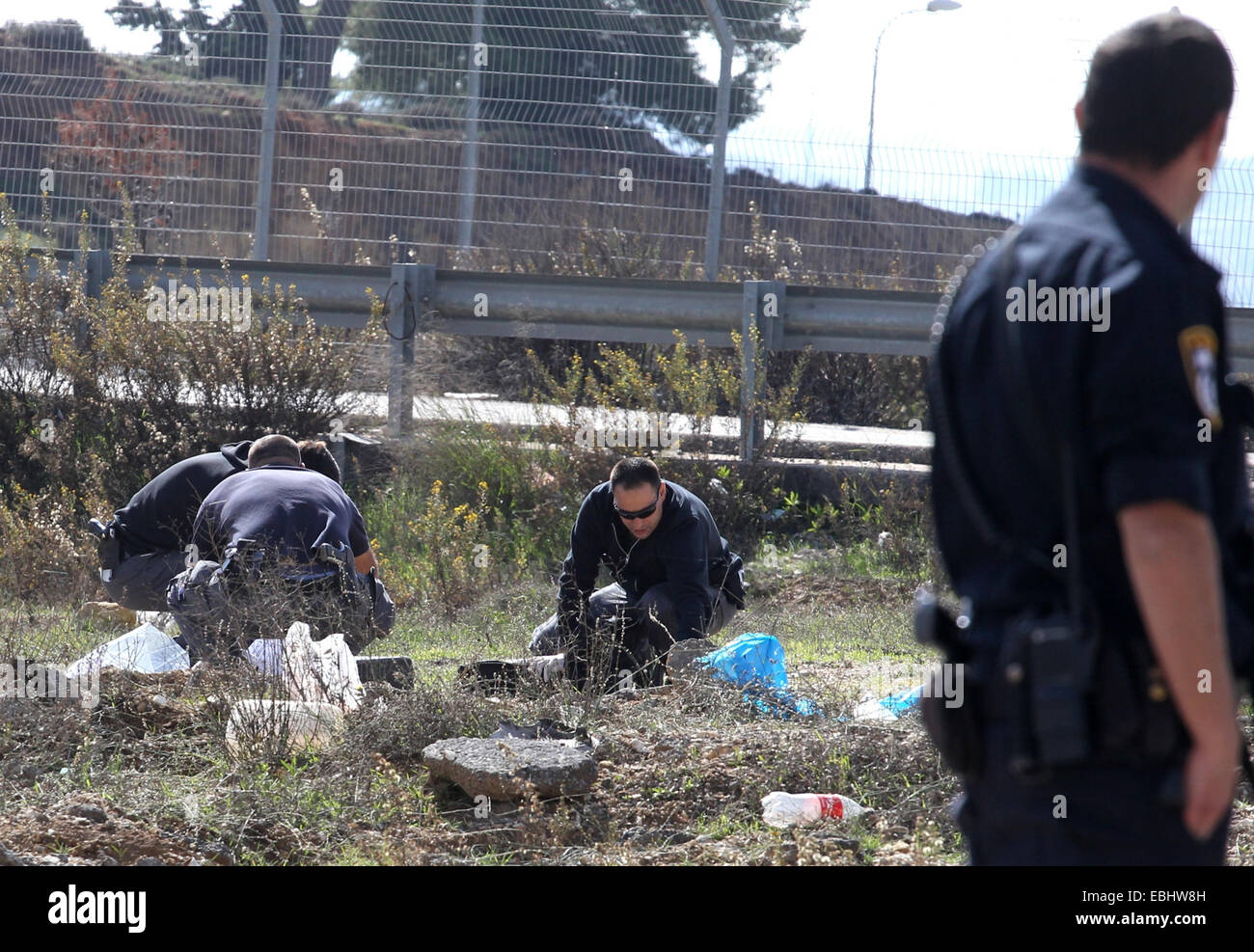 Jerusalem. 1st Dec, 2014. Israeli police carry out forensic work on the site of an alleged stabbing attack outside - Stock Image