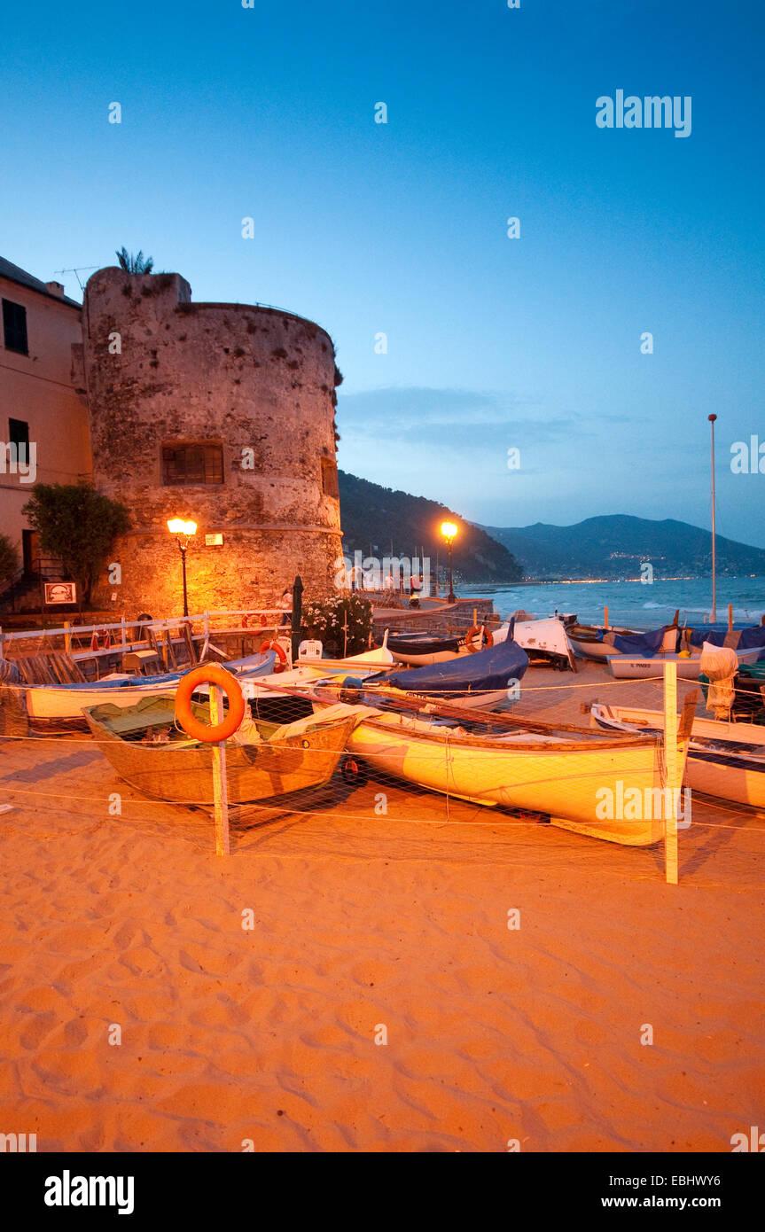 Italy, Liguria, Laigueglia, Bastion from the 16th Century, Fishing Boats on the Beach - Stock Image