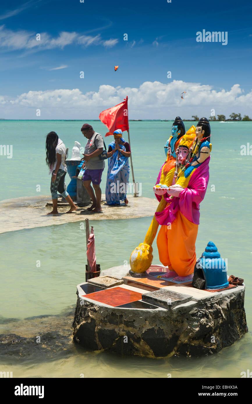 Mauritius, Grand Gaube Sai Shakti Mandir temple, Hindu worshippers at Lord Narasimha seafront shrine Stock Photo