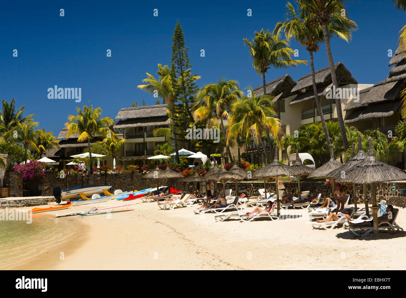 Mauritius, Grand Gaube tourists sunbathing on Veranda Paul et Virginie Hotel and spa beach - Stock Image