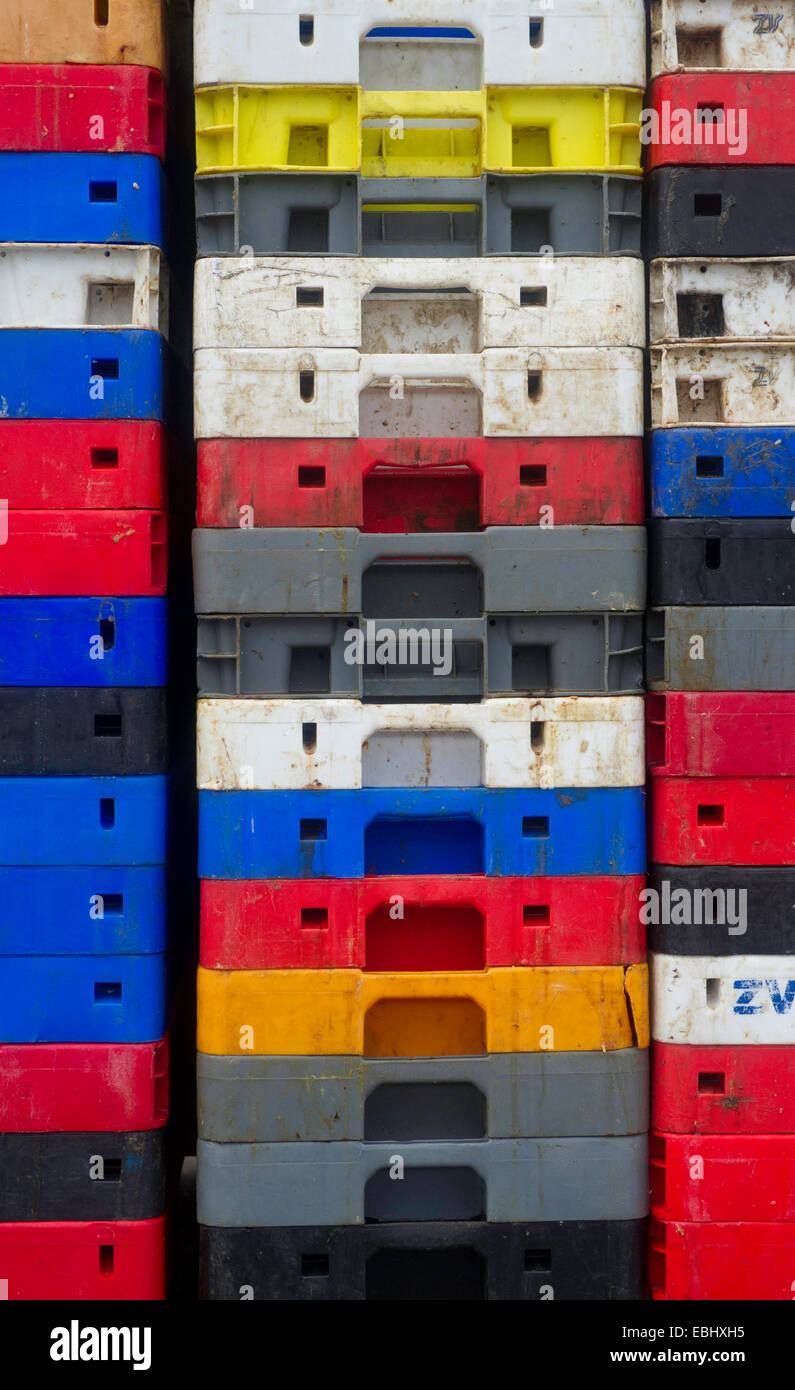 Fish crates different colours all stacked up - Stock Image