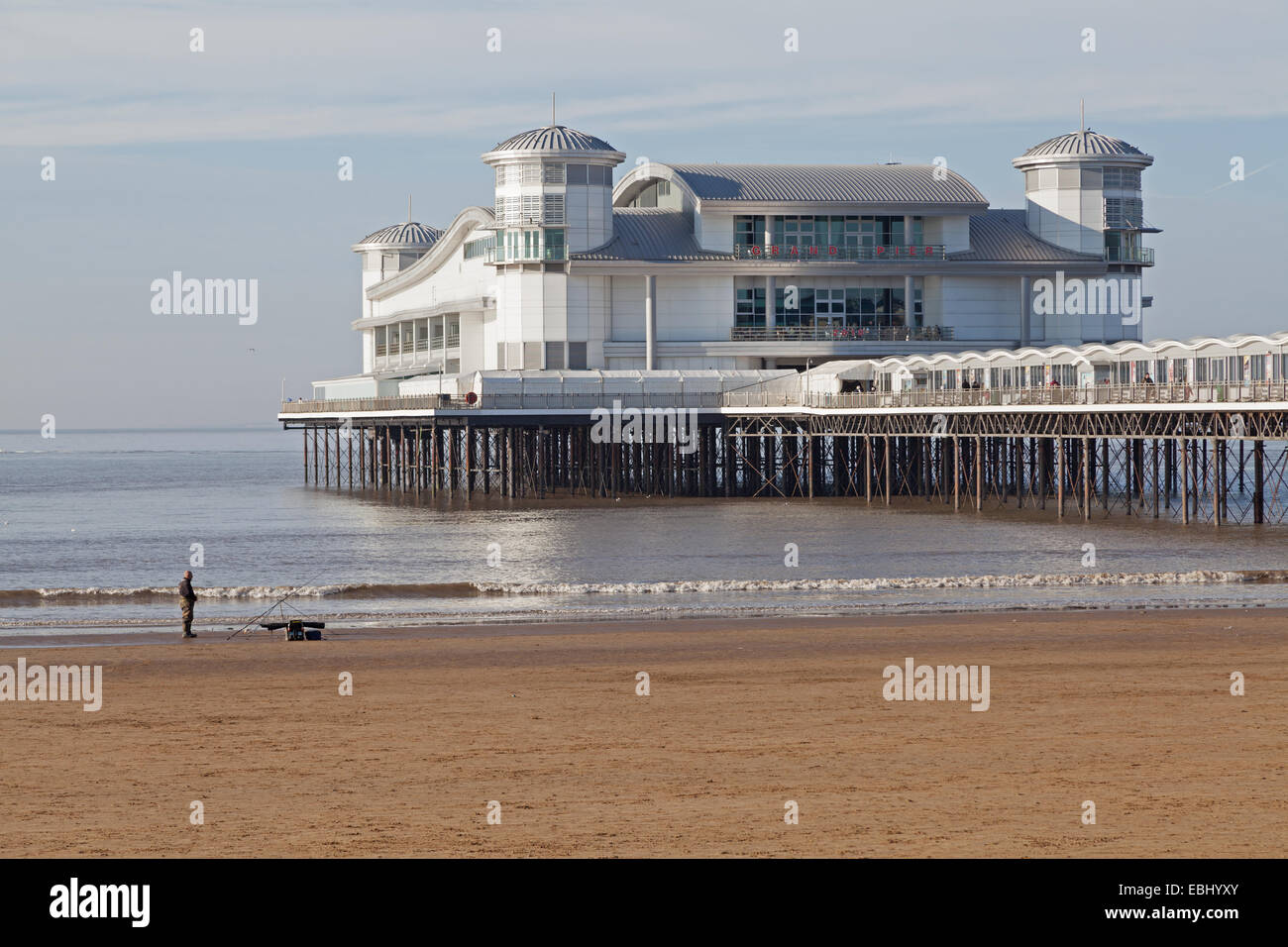 The Grand Pier, Weston-super-Mare, Somerset, England with an angler in the foreground. Stock Photo